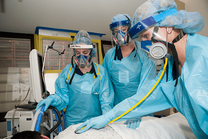 Nurses in the intensive care unit at Allegheny General Hospital  wearing elastomeric masks for protection. (Photo courtesy of Highmark Health)